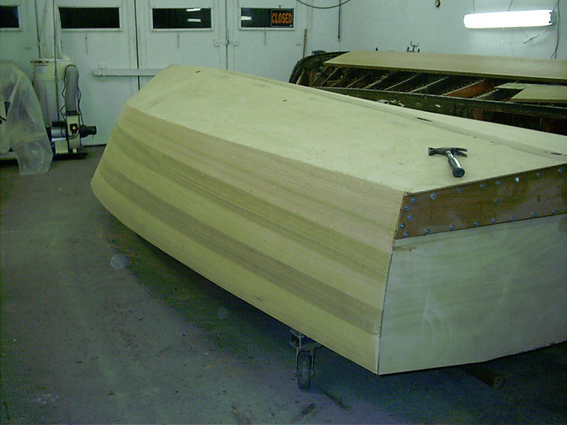 Starboard rear view of sanded side planking.