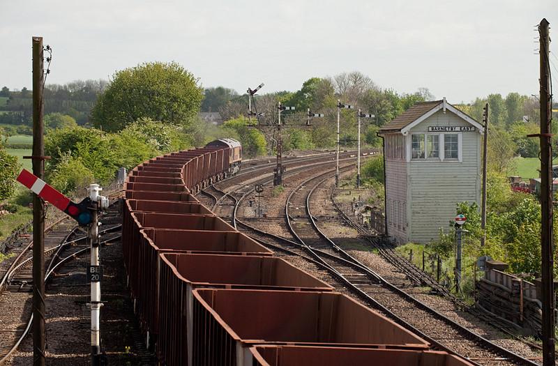 6K22 09:35 Santon-Immingham empty iron ore tipplers passes Barnetby East signal box.