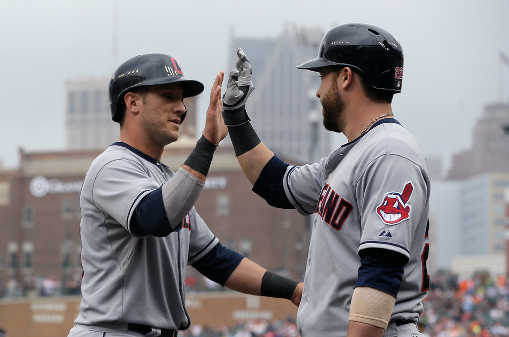 . Cleveland Indians\' Yan Gomes, left, is congratulated by Jason Kipnis after scoring on a single by teammate David Murphy during the ninth inning in the first baseball game of a doubleheader, Saturday, July 19, 2014 in Detroit. (AP Photo/Carlos Osorio)