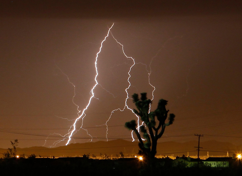 . Lightning strikes and lights up the skies as monsoon storms pass throughout the high deserts area early Monday morning, Aug. 19, 2013 - Lake Los Angeles CA. Photo by Gene Blevins/LA Daily News