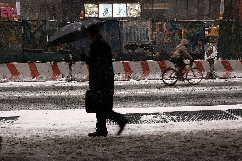 . NEW YORK, NY - JANUARY 26:  A pedestrian walks along a Manhattan street in heavy snow on January 26, 2015 in New York City. New York, and much of the Northeast, is bracing for a major winter storm which is expected to bring blizzard conditions and 18 to 24 inches of snow to the area. New York Mayor Bill de Blasio has announced that only emergency vehicles will be allowed on area roads after 11pm.  (Photo by Spencer Platt/Getty Images)