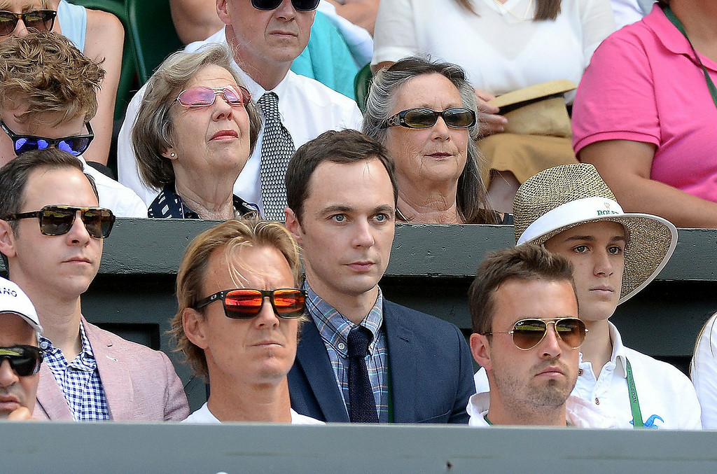 . U.S. actor Jim Parsons, centre, watches from  the players box duirng the Wimbledon women\'s semifinal match between Canada\'s Eugenie Bouchard and  Romania\'s Simona Halep at the All England Lawn Tennis Championships in Wimbledon, London,  Thursday July 3, 2014. (AP Photo/Anthony Devlin/PA)