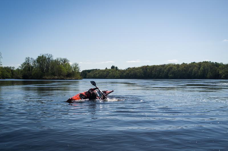 Jamiah playing in his kayak.
