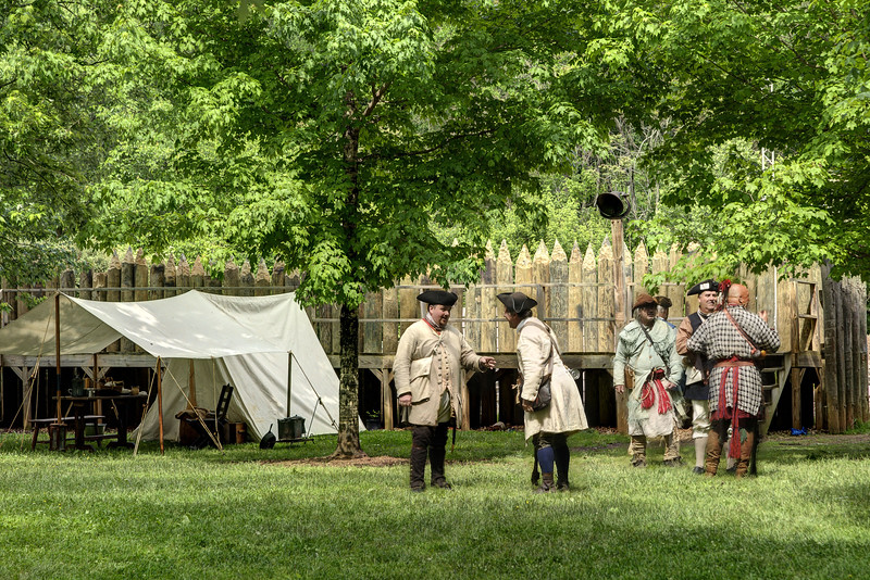 Reenactors chat inside the recreation of Fort Watauga during the Siege of Fort Watauga at Sycamore Shoals State Park in Elizabethton, VA on Saturday, May 17, 2014. Copyright 2014 Jason Barnette  The Siege of Fort Watauga is a two-day reenactment held each year at the recreation of the fort inside Sycamore Shoals State Historic Park. The reenactment brings in dozens of reenactors and hundreds of visitors as they tell the story of an attack on the early settlers village by Dragging Canoe, and how they successfully defended themselves. During the reenactment, the fort is open to the public with demonstrations of all areas of early settler life on the frontiers.
