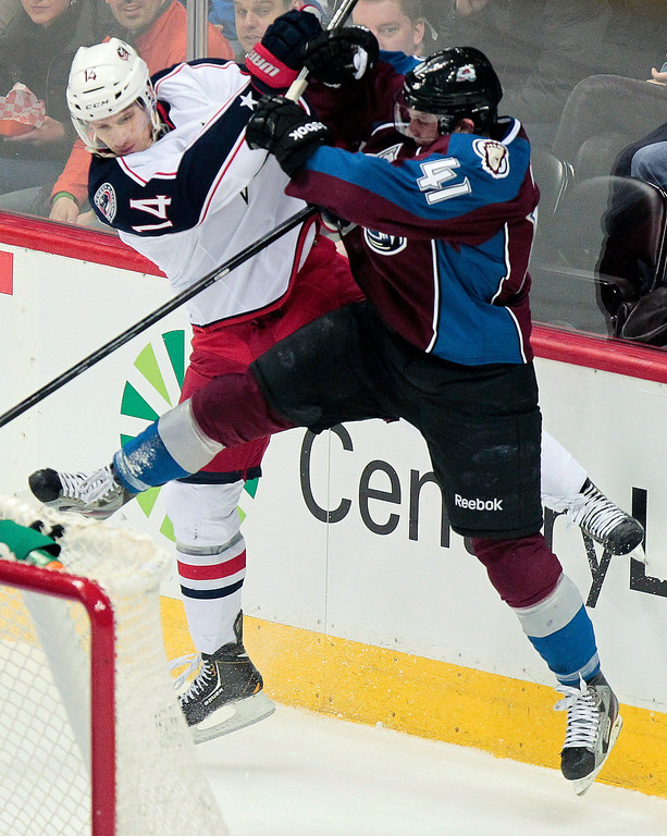 . Columbus Blue Jackets\' Blake Comeau (14) and Colorado Avalanche\'s Tyson Barrie (41) collide during the first period of an NHL hockey game on Monday, April 15, 2013 in Denver. (AP Photo/Barry Gutierrez)