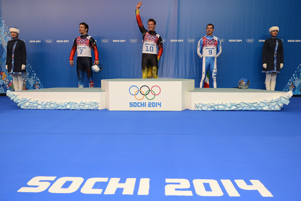 . From left, Silver Medallist, Russia\'s Albert Demchenko; Gold Medallist, Germany\'s Felix Loch; and Bronze Medallist, Italy\'s Armin Zoeggeler, prepare to climb the podium at the Men\'s Luge Singles Flower Ceremony at the Sanki Sliding Center during the Sochi Winter Olympics on February 9, 2014.   LIONEL BONAVENTURE/AFP/Getty Images