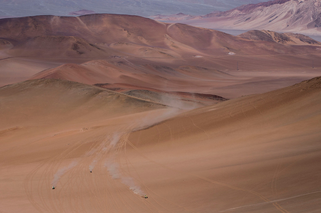 . Two quads and a motorbike race during the fourth stage of the Dakar Rally 2015 between Chilecito, Argentina and Copiapo, Chile, Wednesday, Jan. 7, 2015. The race will finish on Jan. 17, passing through Bolivia and Chile and returning to Argentina where it started. (AP Photo/Felipe Dana)