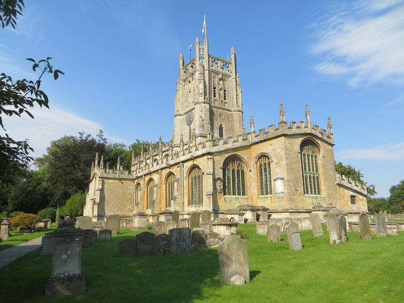 """This is St. Mary's Church in Fairford.  It is a """"wool church,"""" i.e. built in the Middle Ages by a prosperous wool merchant who wanted to use some of his wealth to do good works.  There are many wool churches in the Cotswolds but St. Mary's is special.  It contains a complete set of medieval glass windows, the only one in Britain.  It is a """"Grade 1"""" listed building, that is, defined by statute as of exceptional national significance."""