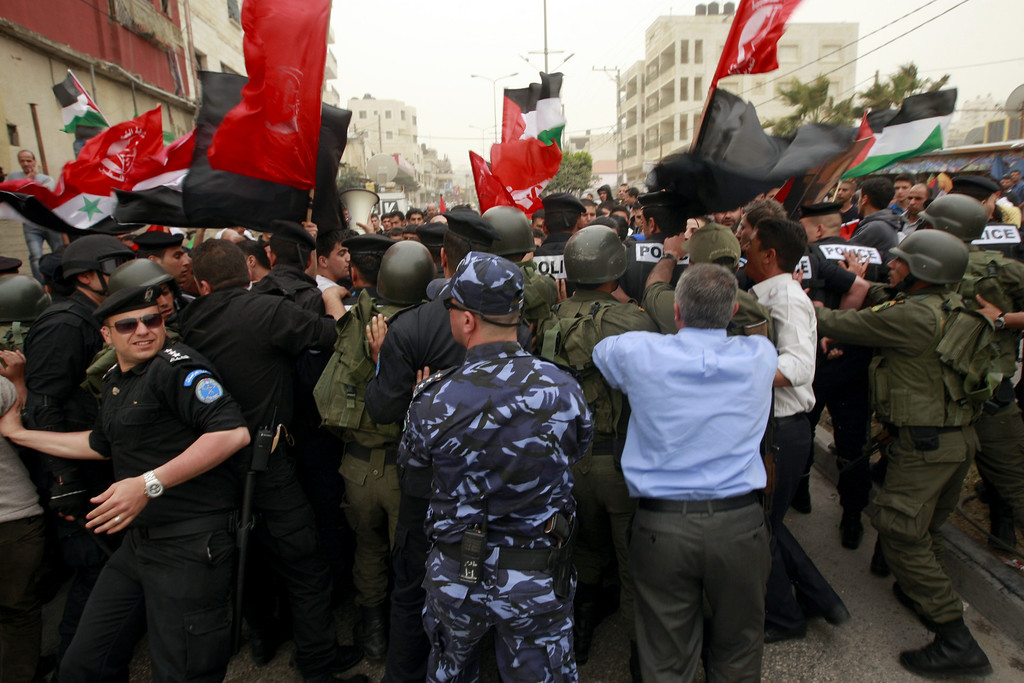 . Police block Palestinian protesters during a rally against U.S. President Barack Obama, in the West Bank city of Bethlehem, Friday, March 22, 2013. (AP Photo/Majdi Mohammed)