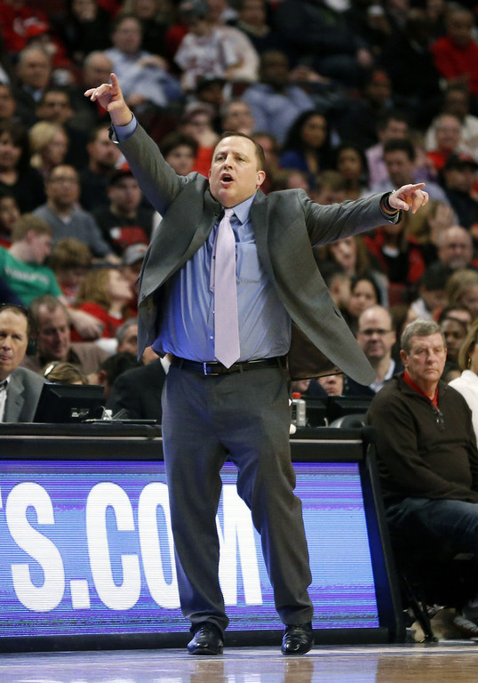 . Chicago Bulls head coach Tom Thibodeau directs his team during the second half of an NBA basketball game against the Denver Nuggets, Friday, Feb. 21, 2014, in Chicago. The Bulls won 117-89. (AP Photo/Charles Rex Arbogast)