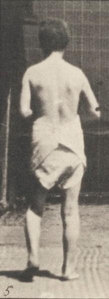 Semi-nude woman spastically walking