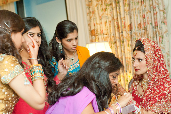 The bride, her sisters and close family and friends help her get ready before the Hindu wedding ceremony at the Wynfrey Hotel in Birmingham, Ala. Kelli + Daniel Taylor Photography