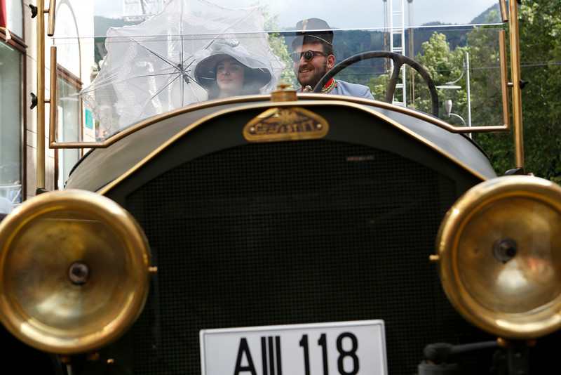 ". Tourists posing for photo on Friday, June 27, 2014, inside replica of the ""Graf & Stift\"" car parked in front of museum at the historical street corner in downtown Sarajevo, where  Gavrilo Princip assassinated Austro-Hungarian heir to the throne Archduke Franz Ferdinand and his wife Sofia, on June 28, 1914. The Sarajevo assassination is officially considered to have been the immediate cause for the beginning of WWI leading Europe into the century of wars started 100 years ago. (AP Photo/Amel Emric)"