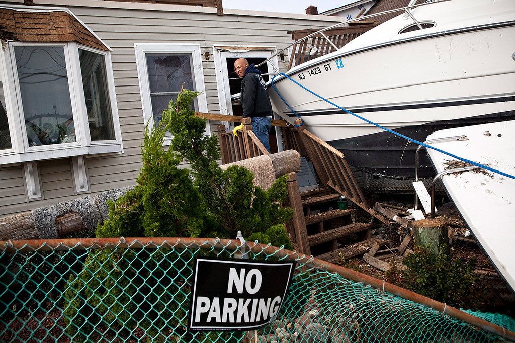 . Clifford Seay helps his girlfriend clean out her home, which was damaged by Superstorm Sandy, on November 1, 2012 in Highlands, New Jersey. Superstorm Sandy, which has left millions without power or water, continues to affect business and daily life throughout much of the eastern seaboard.  (Photo by Andrew Burton/Getty Images)