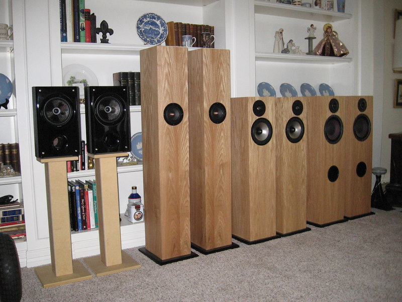 Speakers lined up for the July 22 Lone Star Bottlehead meeting. L to R, the Insignia standmount speakers, Jim Griffin design MLTL single driver bipoles, Zaph Audio two ways using Seas metal cone/dome drivers, the FredAudio F8's having 95dB sensitivity and 1st order crossovers using Eminence Alpha 8 woofers and GR Research T-6 silk dome tweeters. The partially visible drivers at the right edge of the picture are from a pair of Klipsch Cornwalls I'm refinishing.