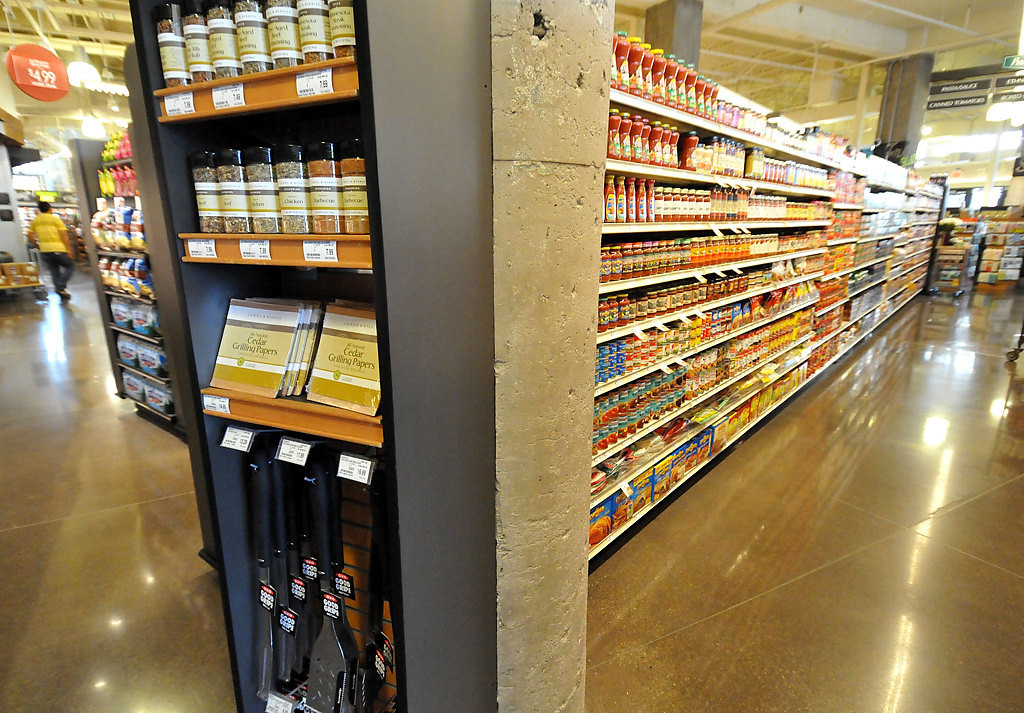 """. \""""Wing Displays\"""" at the end of shopping aisles are big marketing aids at the Lund\'s Store at 12th and Hennepin in Minneapolis. (Pioneer Press: John Doman)"""