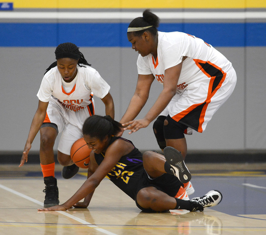 . McClymonds High\'s Ahjahna Coleman (25), left, and Da\' Ja\' Nay Powell (32) battle Oakland Tech High\'s Hadiyah Owens (23) for a loose ball in their Oakland Section high school girls basketball championship game played at Merritt College in Oakland, Calif. on Thursday, Feb. 28, 2013. (Dan Honda/Staff)