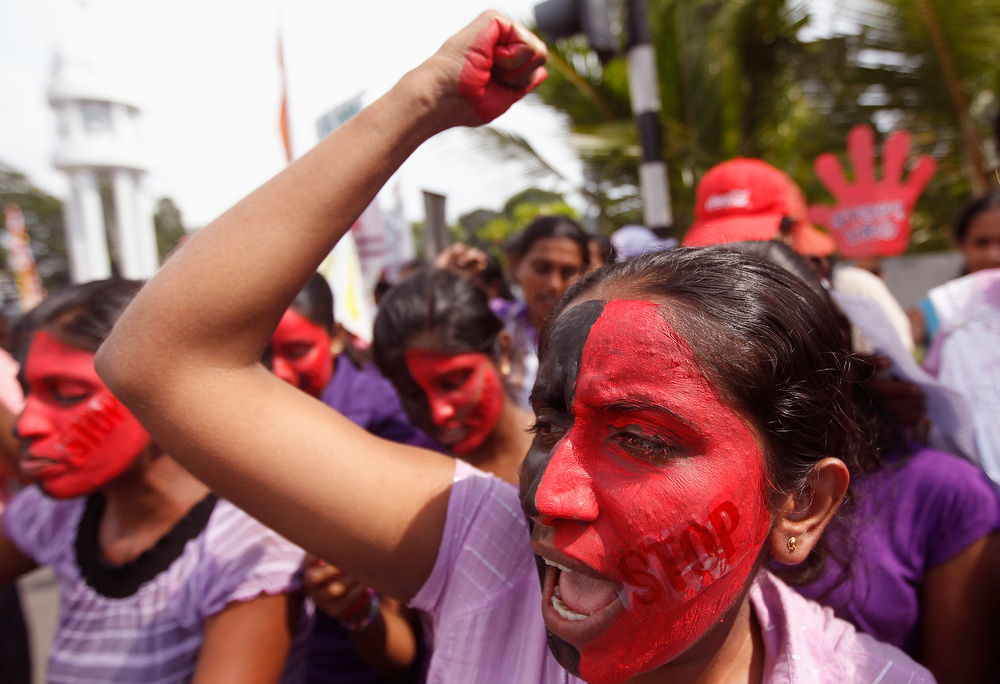 . Sri Lankan women shout slogans during a protest to mark International Women\'s Day in Colombo March 8, 2013. Protesters demanded government action for domestic violence and rape issues in the country.   REUTERS/Dinuka Liyanawatte