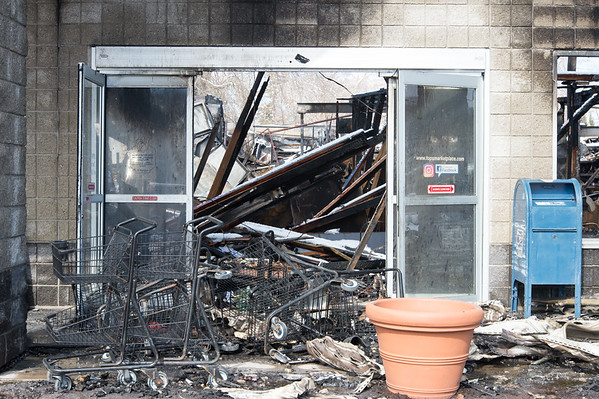 03/04/19 Wesley Bunnell | Staff Fire destroyed Tops Marketplace located at 887 Meriden-Waterbury Tpke in Southington on Monday night. Shopping carts and debris line the front entrance to the store.