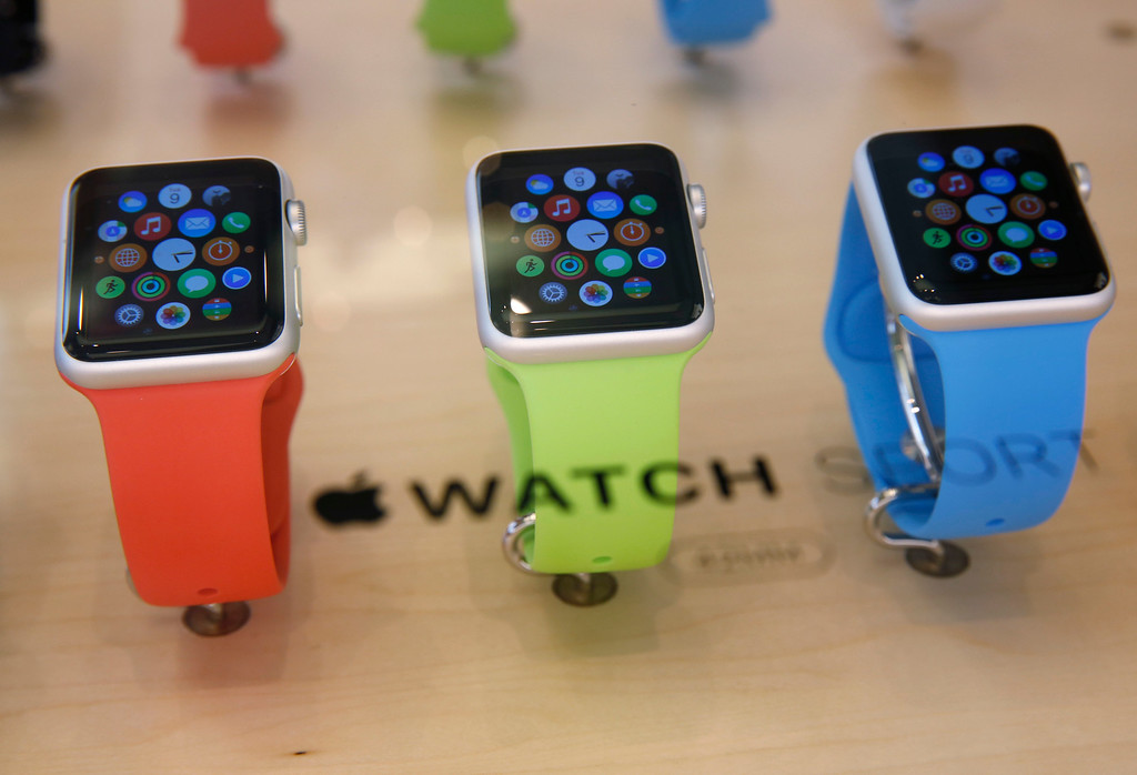 . Apple Watches are displayed at an Apple Store in Hong Kong Friday, April 10, 2015. From Beijing to Paris to San Francisco, the Apple Watch made its debut Friday. Customers were invited to try them on in stores and order them online. (AP Photo/Kin Cheung)