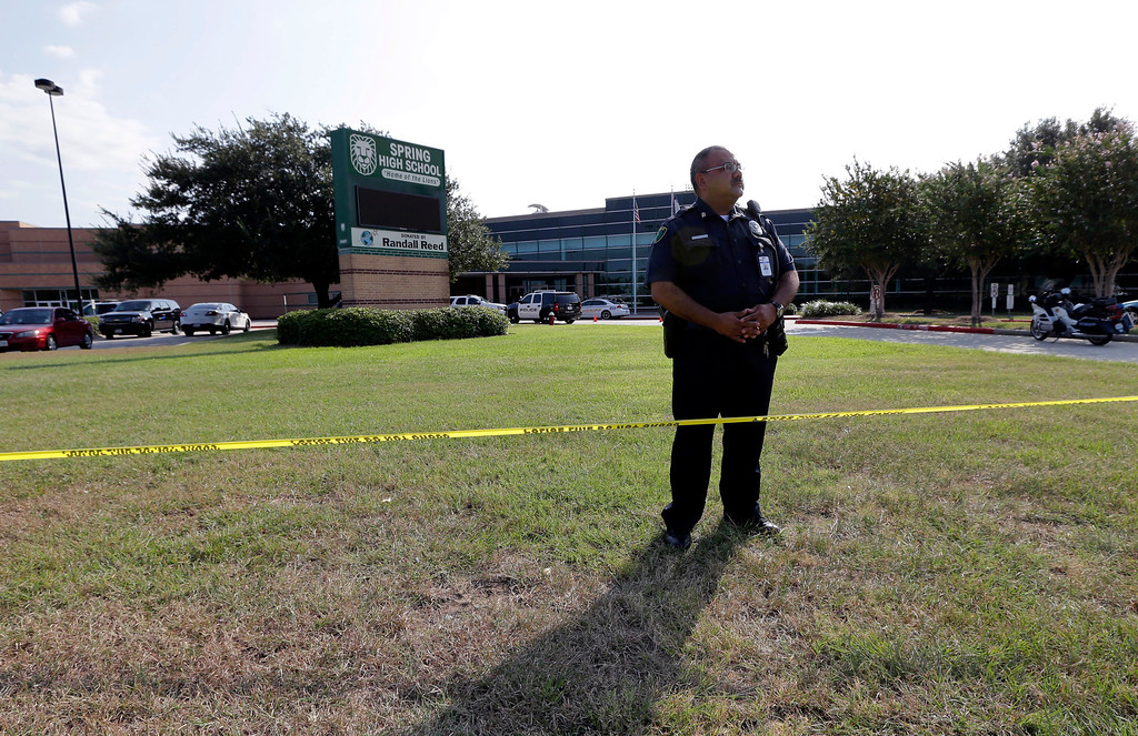 . A Harris County Sheriff\'s Deputy stands outside Spring High School Wednesday, Sept. 4, 2013, in Spring, Texas.  (AP Photo/David J. Phillip)
