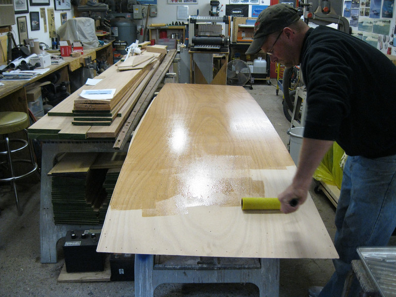 Epoxy being applied to the third layer of bottom plywood.