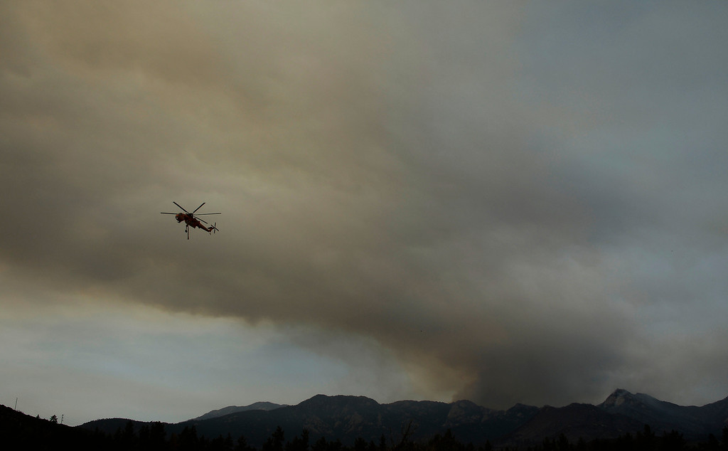 . during the Mountain Fire near Idyllwild, California July 18, 2013. The blaze erupted on Monday afternoon about 100 miles (161 km) east of Los Angeles in the scenic but rugged San Jacinto Mountains that overlook Palm Springs, Rancho Mirage and several smaller desert towns.  Photo by Gene Blevins/LA Daily News