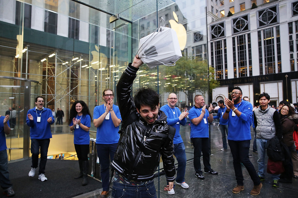 . The first customer in line, Rami Shamis, holds up his new iPad Air at the Apple Store on November 1, 2013 in New York City. The new iPad, which will also come in a mini version, is 20% thinner and 28% lighter than the current fourth-generation iPad. It has the same 9.7-inch screen as previous iPads and uses the same A7 processing chip that\'s in the iPhone 5S. The iPad Air, which went on sale today, will start at $499 for a 16GB Wi-Fi-only model and go up to $629 for a 16GB with 4G LTE connectivity.  (Photo by Spencer Platt/Getty Images)