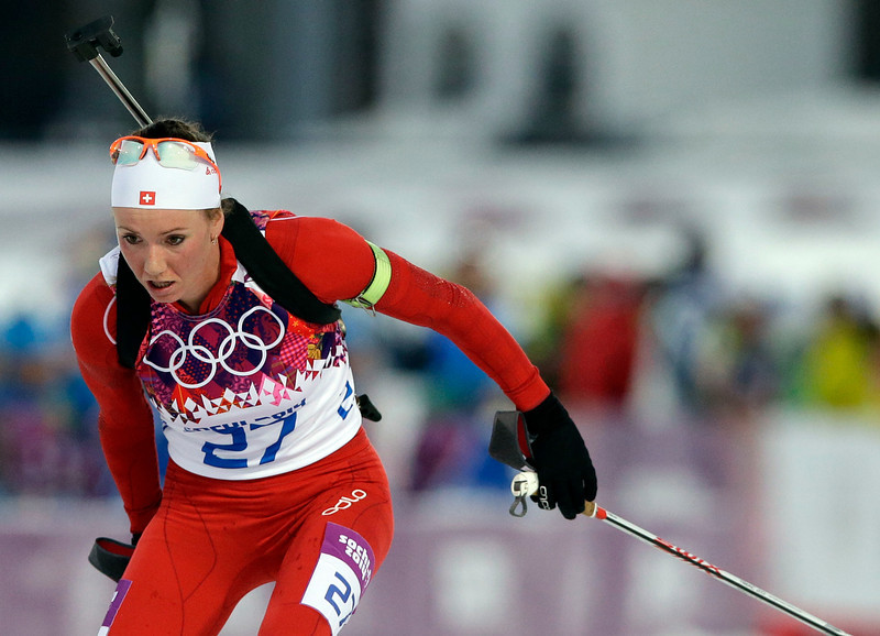 . Switzerland\'s Selina Gasparin competes to win the silver medal in the women\'s biathlon 15k individual race, at the 2014 Winter Olympics, Friday, Feb. 14, 2014, in Krasnaya Polyana, Russia. (AP Photo/Lee Jin-man)