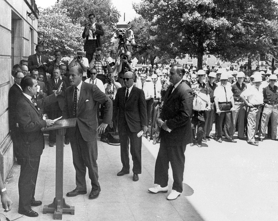 . Alabama Gov. George C. Wallace, left, raises his hand to stop U.S. Deputy Attorney General Nicholas Katzenbach as Wallace stands in front of a door to keep blacks from enrolling at the University of Alabama in Tuscaloosa, Ala on June 11, 1963.  (AP Photo/Tuscaloosa News, Calvin Hannah)