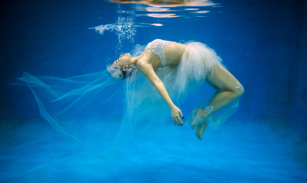. This photo taken on September 3, 2014 shows  Leng Yuting, 26, posing underwater for her wedding pictures at a photo studio in Shanghai, ahead of her wedding next year. Her fiance Riyang said they had their wedding photographs taken underwater because \'its romantic and beautiful\'. Mr Wedding studio owner, Tina Lui, started providing underwater pictures four years ago.   AFP PHOTO / JOHANNES  EISELE/AFP/Getty Images