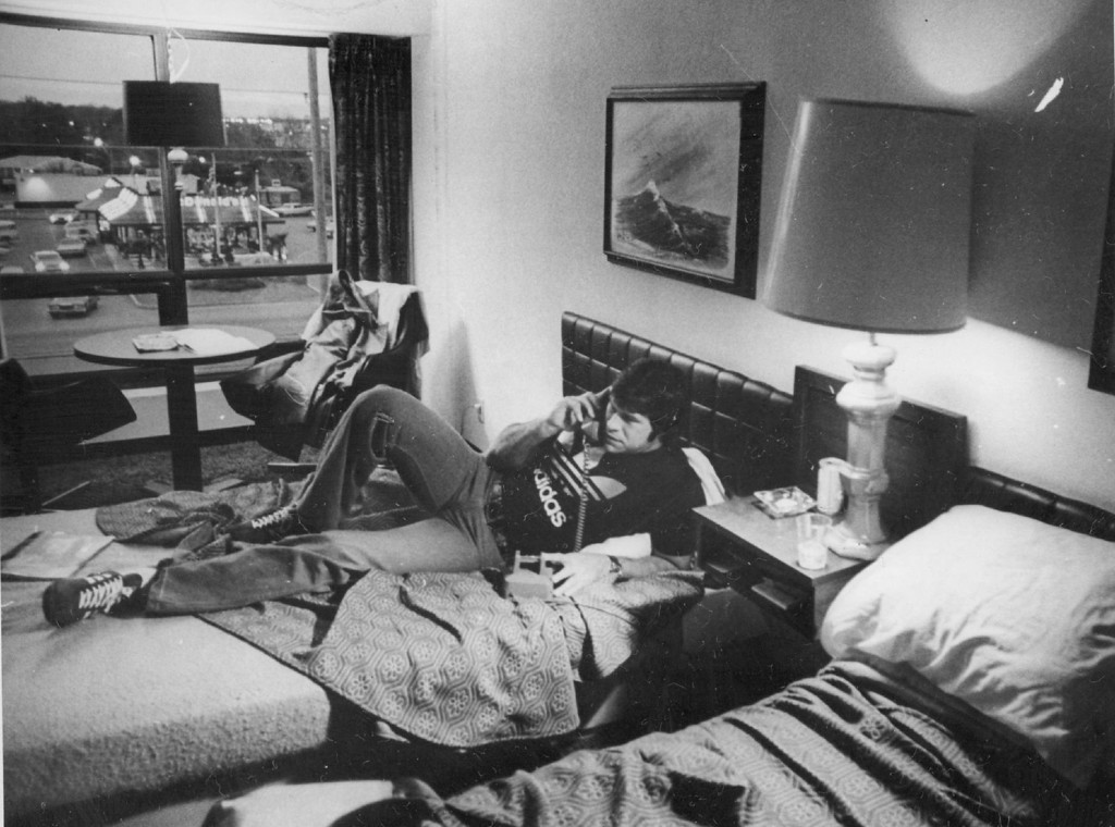 . JAN 1978 - The Long Wait Sets In For Sunday After a week of carnival atmosphere, Denver Bronco center Mike Montler passes time on phone in his hotel room. (Bill Wunsch/The Denver Post)
