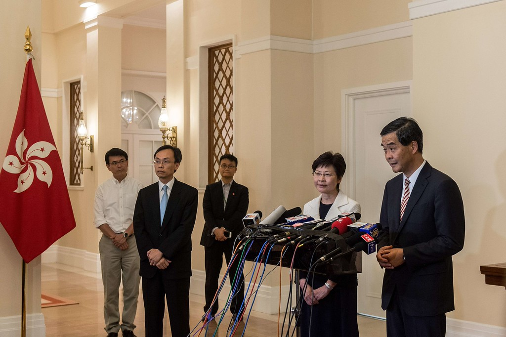 . Hong Kong\'s embattled leader, Chief Executive Leung Chun-ying (R) and Chief Secretary Carrie Lam (2nd R) hold a press conference at Leung\'s official residence in Hong Kong on October 2, 2014, just minutes before a midnight deadline set by protesters demanding his resignation expired. Leung late on October 2 rejected protesters\' calls for him to resign, but in a significant concession agreed to talks with a students group involved in mass pro-democracy demonstrations that have paralysed parts of the city.     ANTHONY WALLACE/AFP/Getty Images