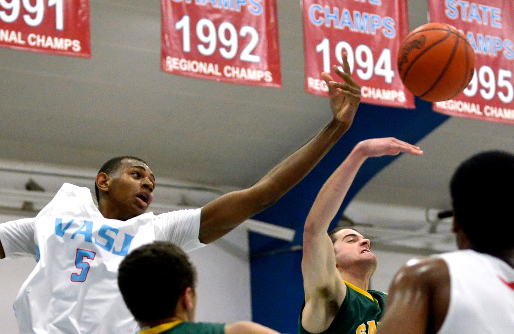. Jeff Forman/JForman@News-Herald.com Dererk Pardon reaches for a rebound during the firts half of the Vikings\' 82-76 loss to St. Edward Feb. 20 at Villa Angela -St. Joseph High School.