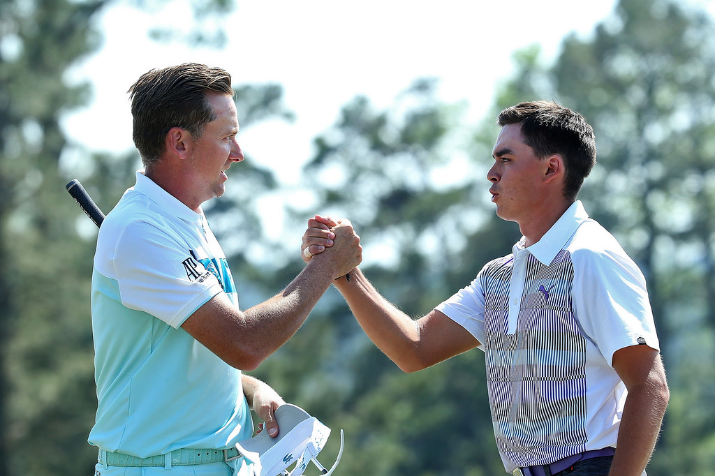 . (L-R) Ian Poulter of England and Rickie Fowler of the United States shake hands on the 18th green during the third round of the 2014 Masters Tournament at Augusta National Golf Club on April 12, 2014 in Augusta, Georgia.  (Photo by Andrew Redington/Getty Images)