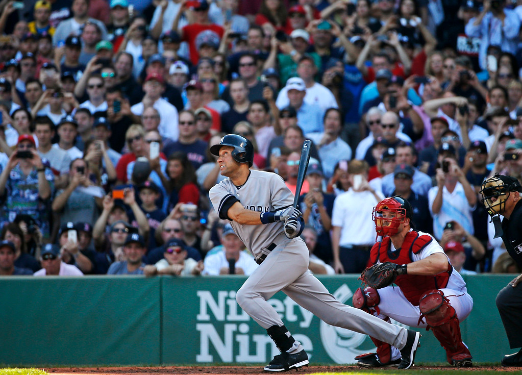 . New York Yankees designated hitter Derek Jeter follows through on a single in the third inning against the Boston Red Sox in a baseball game Sunday, Sept. 28, 2014, in Boston. It is the last baseball game of Jeter\'s career. (AP Photo/Elise Amendola)