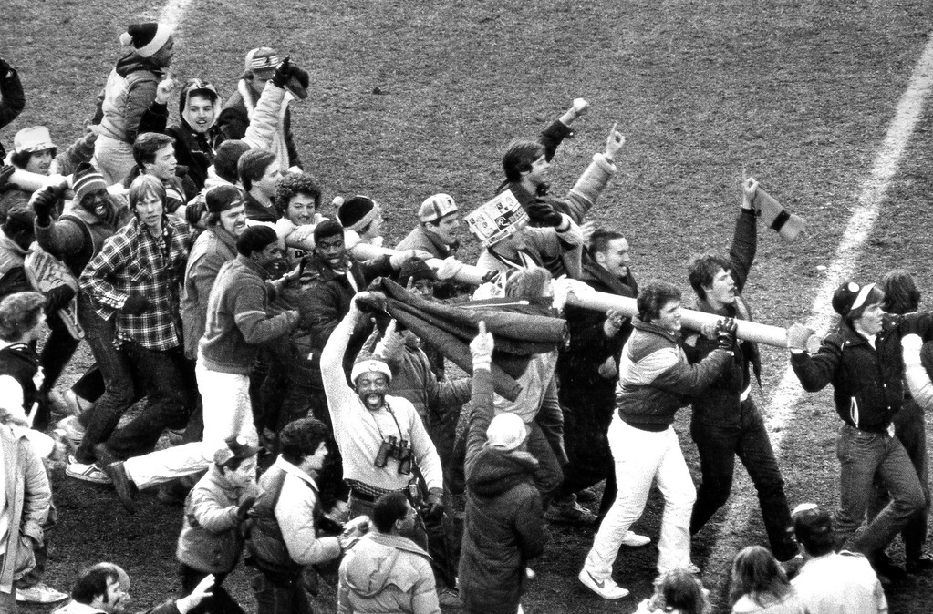 . Washington Redskins fans carry a piece of the goal post off the field after their team defeated the Dallas Cowboys 31-17 for the NFC championship in Washington, earning a trip to the Super Bowl, Jan. 22, 1983. (AP Photo)