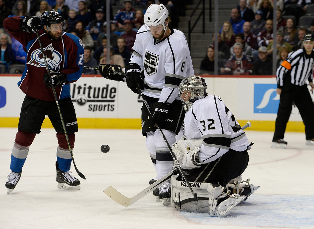 . DENVER, CO - FEBRUARY 18: Los Angeles Kings goalie Jonathan Quick (32) makes a save as Colorado Avalanche center Maxime Talbot (25) and Los Angeles Kings defenseman Jake Muzzin (6) watche the puck drop during the first period February 18, 2015 at Pepsi Center. (Photo By John Leyba/The Denver Post)