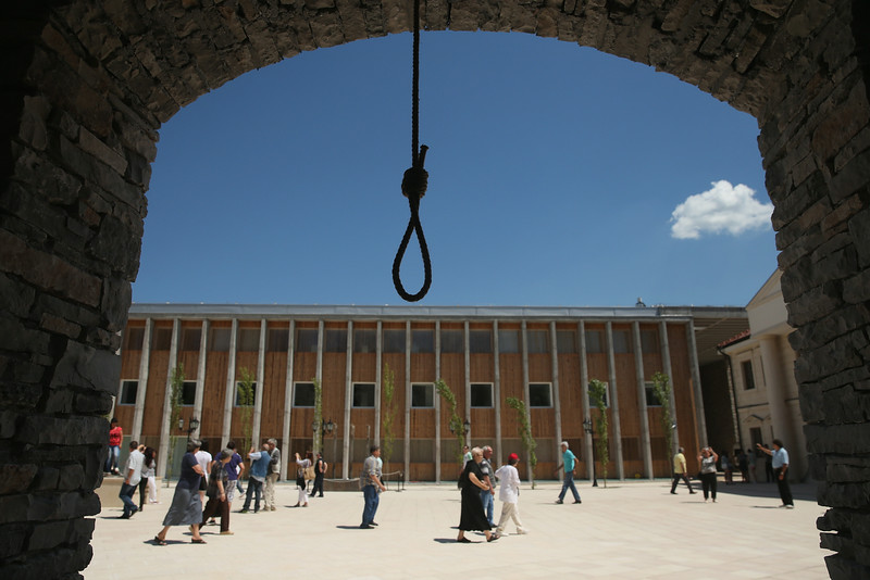 . A noose that will be part of a theatrical performance later in the day hangs in a building\'s window frame at the mock-village of Andricgrad on St. Vitus Day in Srpska Republika on June 28, 2014 in Visegrad, Bosnia and Herzegovina. Serbian leaders are scheduled to hold ceremonies at Andricgrad later in the day to mark the centenary of the assassination of Austrian Archduke Franz Ferdinand on June 28, 1914, by Serbian secessionist Gavrilo Princip, an event that propelled Europe into World War I. The city of Sarajevo is holding its own commemoration, though Serbian leaders are boycotting the Sarajevo events, claiming the Bosniaks have turned the commemoration too partisan. Andricgrad was built by Serbian film director Emir Kusturica and will become the set for a film about Yugoslav poet Ivo Andric.  (Photo by Sean Gallup/Getty Images)
