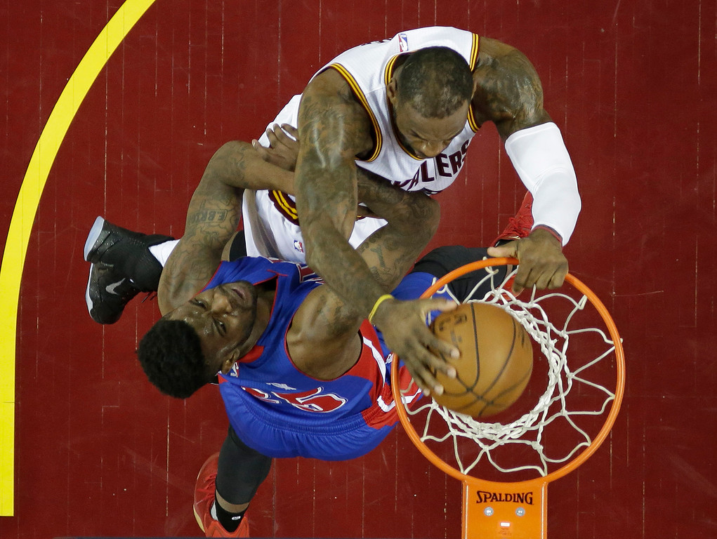 . Cleveland Cavaliers\' LeBron James, top, dunks the ball against Detroit Pistons\' Reggie Bullock in the first half in Game 2 of a first-round NBA basketball playoff series, Wednesday, April 20, 2016, in Cleveland. (AP Photo/Tony Dejak)