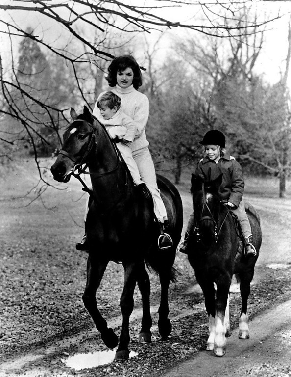 . Jacqueline goes for a ride with Caroline while holding John Jr. on  Nov. 19, 1962.  John F. Kennedy Presidential Library and Museum