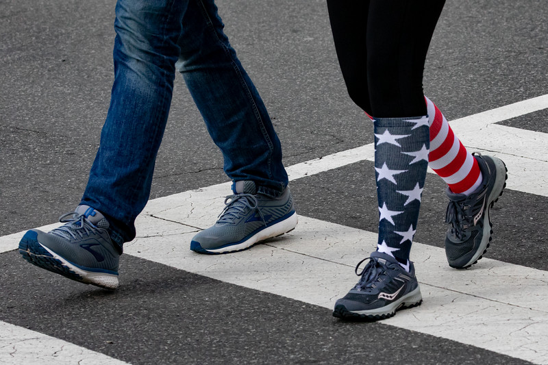 A pedestrian crossing near the U.S. Capitol wears American flag socks on inauguration day