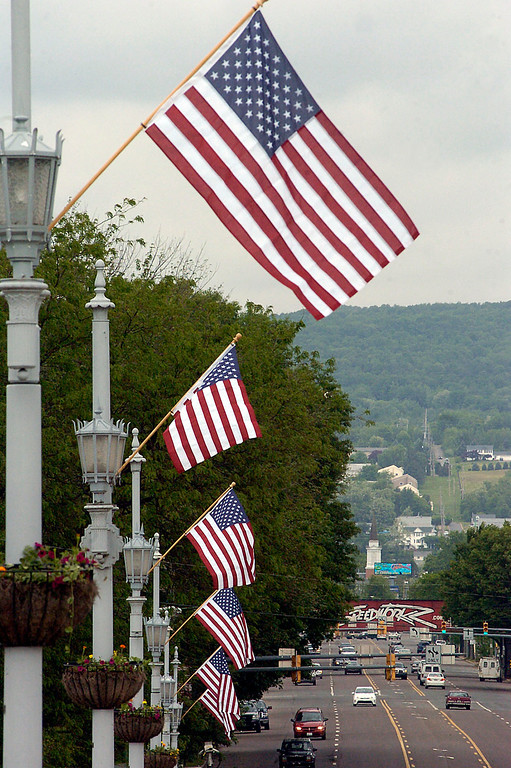 . American flags fly across the Market Street Bridge in Wilkes-Barre, Pa., Thursday May 23, 2013. Wilkes-Barre City DPW workers installed the flags in conjucntion with veterans organizations and Memorial Day. (AP Photo/The Citizens\' Voice, Mark Moran)