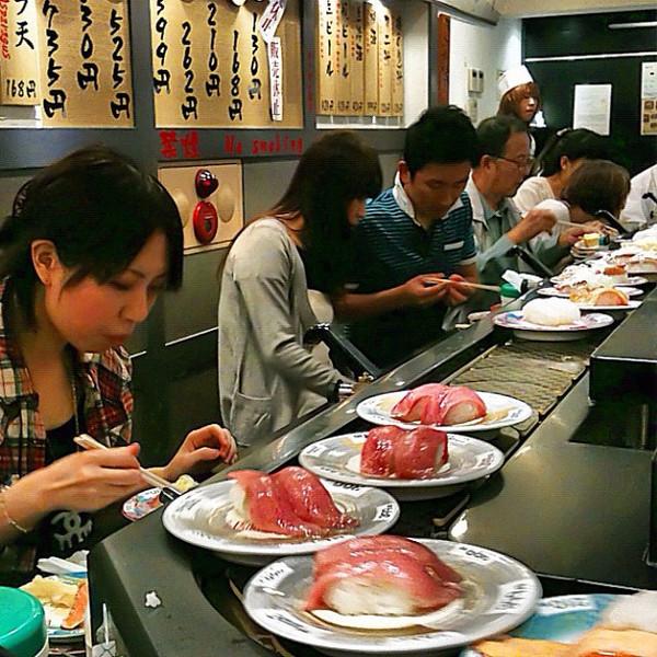 All aboard the sushi train! This plus a 45-item a la carte menu at $1.60-per-plate = gorge