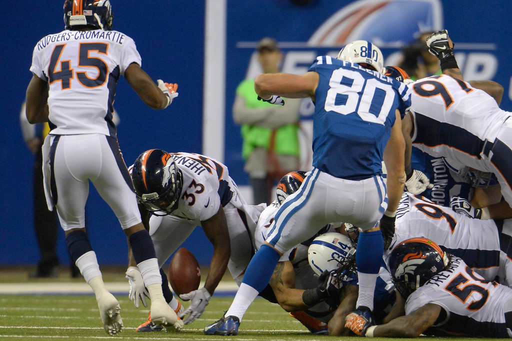 . Strong safety Duke Ihenacho (33) of the Denver Broncos recovers a fumble at Lucas Oil Stadium. October 20, 2013 Indianapolis, Indiana. (Photo By Joe Amon/The Denver Post)