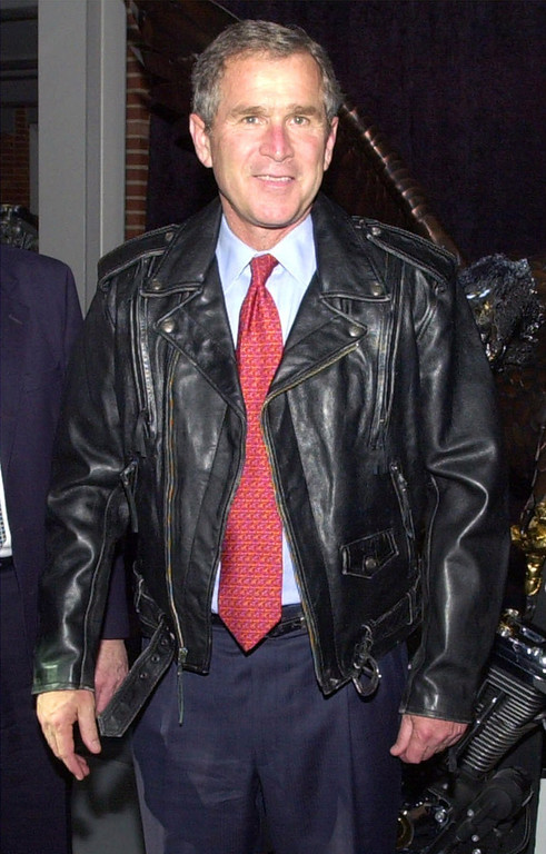 . Republican presidential hopeful Texas Gov. George W. Bush poses in a leather jacket given to him after a tour of the Harley-Davidson motorcycle plant Thursday, March 30, 2000, in  Milwaukee. (AP Photo/Robert F. Bukaty)
