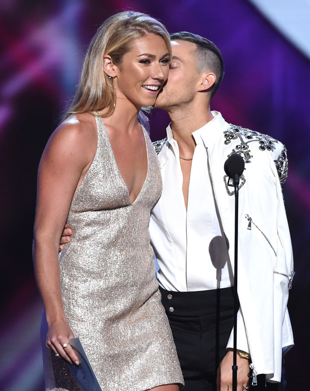 . Adam Rippon, right, and Mikaela Shiffrin stand on stage to present the award for best game at the ESPY Awards at Microsoft Theater on Wednesday, July 18, 2018, in Los Angeles. (Photo by Phil McCarten/Invision/AP)