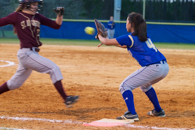 Menendez player Stephanie Kimball (#4) catches the ball to force out
