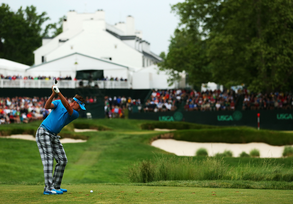 . Ian Poulter of England hits his tee shot on the 13th hole during Round One of the 113th U.S. Open at Merion Golf Club on June 13, 2013 in Ardmore, Pennsylvania.  (Photo by Andrew Redington/Getty Images)