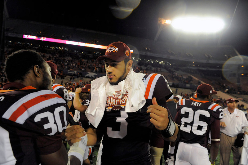 . Virginia Tech quarterback Logan Thomas (3) and cornerback Donaldven Manning, left, celebrate after their 13-10 win in overtime of an NCAA college football Russell Athletic Bowl game against Rutgers, Friday, Dec. 28, 2012, in Orlando, Fla. (AP Photo/Brian Blanco)
